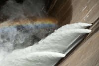 Hydrodam with rainbow over water